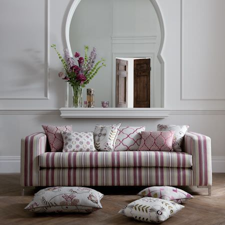 Clarke and Clarke -  Bukhara Fabric Collection - Purple striped sofa with various white and pink patterned cushions