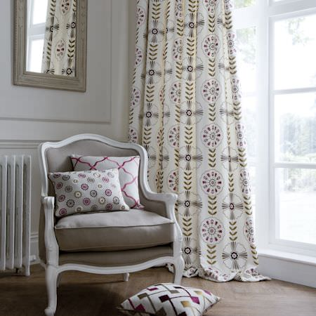 Clarke and Clarke -  Bukhara Fabric Collection - Cream curtain with modern flower print and spot and crisscross cushions