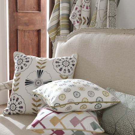 Clarke and Clarke -  Bukhara Fabric Collection - White cushions and fabrics with spot, stripe and floral patterns