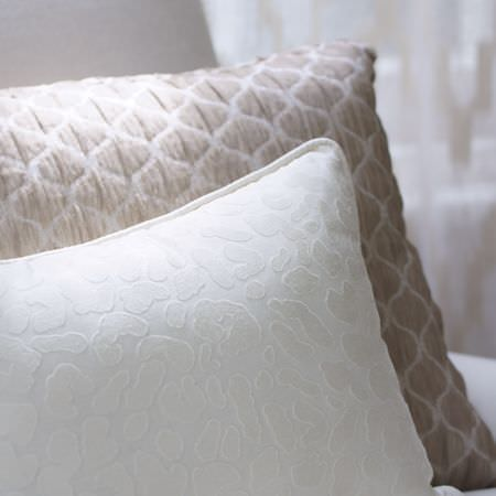 Clarke and Clarke -  Cadoro Fabric Collection - White cushion with a subtle pattern which is slightly raised, and a champagne and cream textured patterned cushion