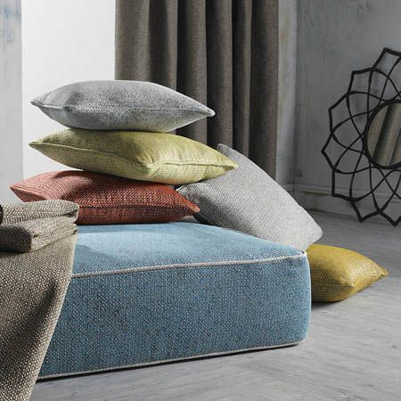 Clarke and Clarke -  Casanova Fabric Collection - Powder blue seat cushion with scatter cushions in plain grey, lime green and brick red, with abrown throw and a mirror