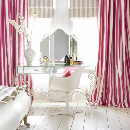 Clarke and Clarke -  Chateau Fabric Collection - White roman blinds decorated with light grey stripes and vibrant curtains featuring a pattern of pink stripes