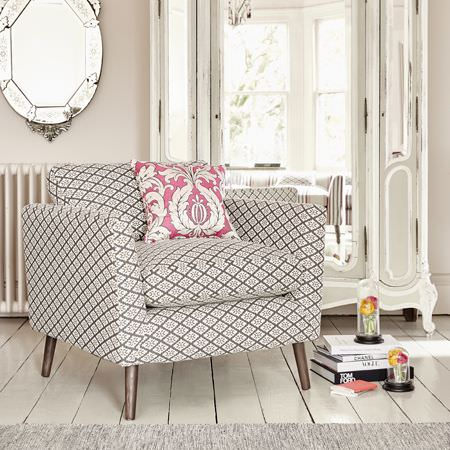 Clarke and Clarke -  Chateau Fabric Collection - Modern upholstered sofa with wooden legs and a design featuring elegant diamond-like shapes