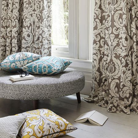 Clarke and Clarke -  Chateau Fabric Collection - Brown curtains with elegant floral design and a matching design on vibrant blue and ochre cushions