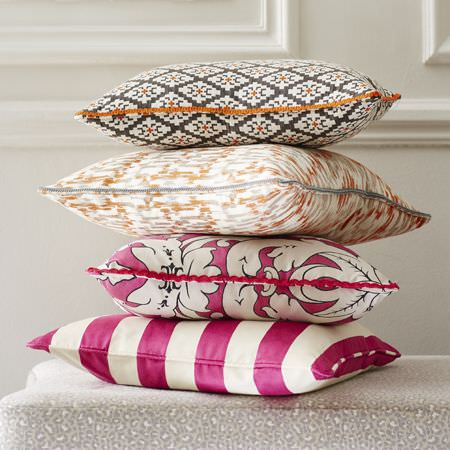 Clarke and Clarke -  Chateau Fabric Collection - Cushion with pink and beige stripes, pink cushion with white floral design and one with abstract pattern