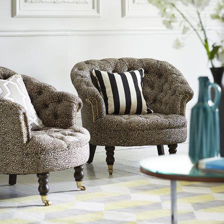 Clarke and Clarke -  Chateau Fabric Collection - Luxurious upholstered armchairs with simple white dotted pattern, with a black and white and light grey cushions