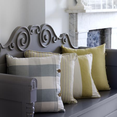 Clarke and Clarke -  Country Linens Fabric Collection - Modern carved wooden bench painted grey, with two green and white stripe, one plain green and one blue checked cushion with button detail