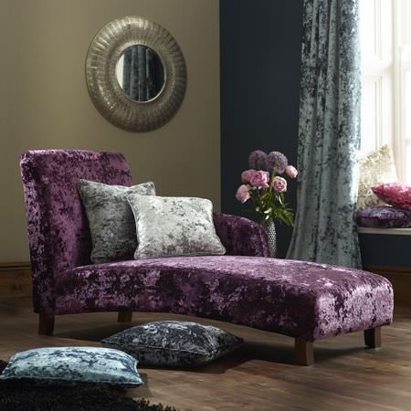 Clarke and Clarke -  Crush Fabric Collection - Textured purple chaise longue with grey, blue and silver textured scatter cushions and curtains, beside a round mirror