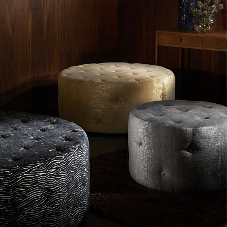 Clarke and Clarke -  Dimensions Fabric Collection - 3 large round footstools; one in light gold, one in gunmetal grey, and one with a subtle black and white streaked pattern