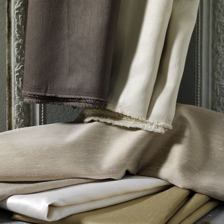 Clarke and Clarke -  Emperor Fabric Collection - Silk effect fabrics in champagne, cream and gold, with two other plain cream and chocolate coloured cloths