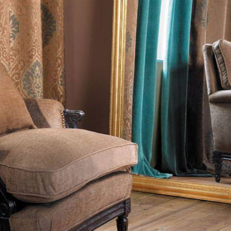 Clarke and Clarke -  Eton Fabric Collection - Blue plain curtains, brown drapes with a classic print and upholstered chair