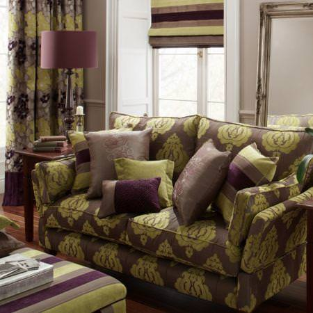Clarke and Clarke -  Extravagance Fabric Collection - Brown and green classical curtains and sofa with plain and striped cushions