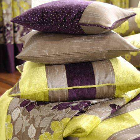 Clarke and Clarke -  Extravagance Fabric Collection - Purple, brown and green chenille striped cushions and flowery fabric
