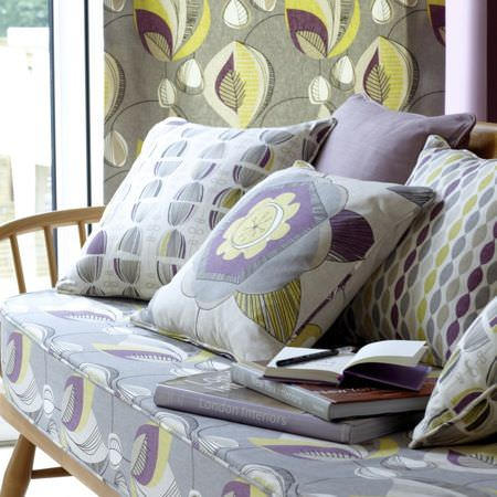 Clarke and Clarke -  Festival Fabric Collection - Purples, yellows and greys with floral and oval repeating patterns, in a contemporary setting