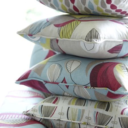 Clarke and Clarke -  Festival Fabric Collection - A quilt and cushions with lively a modern pattern