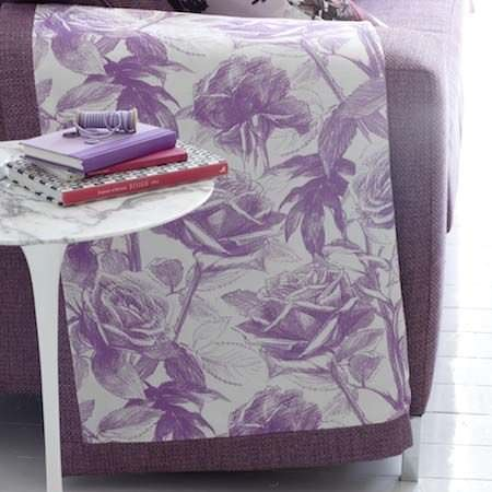Clarke and Clarke -  Floribunda Fabric Collection - A white and purple quilt, with a printed, rose pattern and a hand drawn style