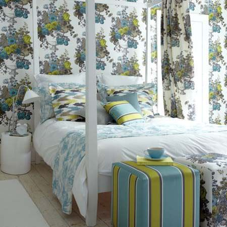 Clarke and Clarke -  Floribunda Fabric Collection - Bright blues and greens in stripe floral and zigzag patterns are used for bedspreads, pillows, curtains and upholstery in this bedroom