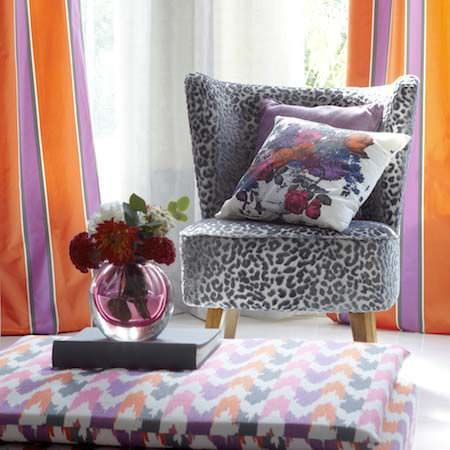 Clarke and Clarke -  Floribunda Fabric Collection - A colourful, patterned interior of intricate flowers and simple prints, in orange, purple, black and white