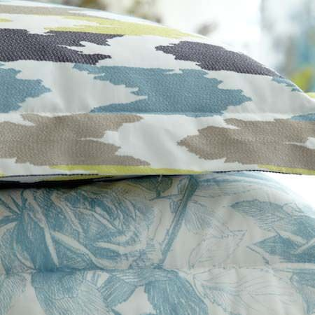 Clarke and Clarke -  Floribunda Fabric Collection - Detail from rose garden and zigzag patterend prints in light blues, browns and greens