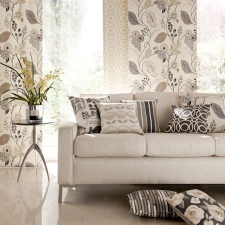 Clarke and Clarke -  Folia Fabric Collection - Cream three seater sofa with cream, grey and brown scatter cushions in stripes, patterns and florals, with matching fabric and a side table
