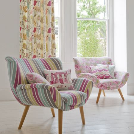 Clarke and Clarke -  Folia Fabric Collection - Turquoise, green, grey, pink, cream striped armchair, with armchair in grey and pink florals, cream and pink patterned cushions and curtains