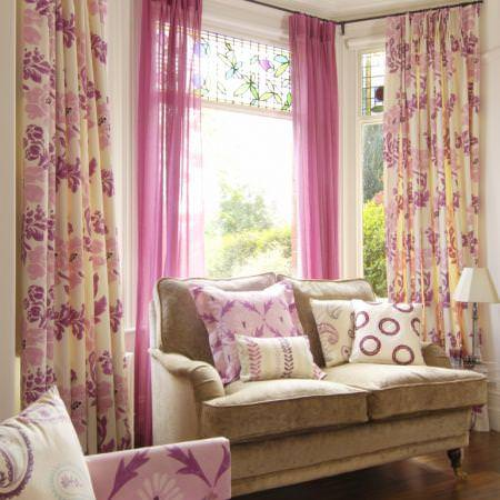 Clarke and Clarke -  Fresco Fabric Collection - Cream floral curtains with pink sheer drapes and various patterned cushions