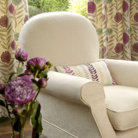 Clarke and Clarke -  Fresco Fabric Collection - Cream and pink floral designed curtains with cream upholstered armchair and leaf print cushion