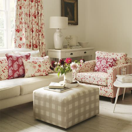Clarke and Clarke -  Genevieve Fabric Collection - Armchair with red flowers and stripes, cream sofa, checked cube footstool, red and cream floral curtains and cushions, cream desk and lamp