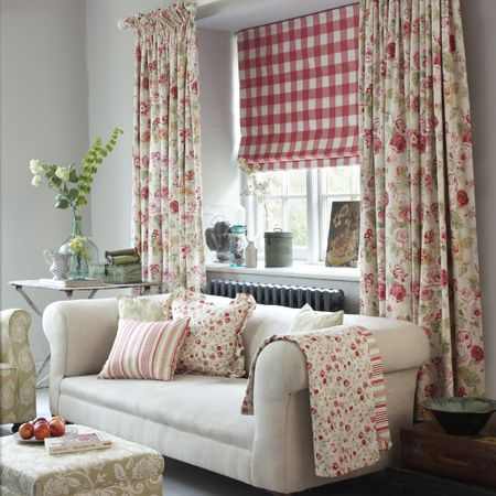 Clarke and Clarke -  Genevieve Fabric Collection - Fabric and cushions printed with small flowers and stripes, large floral curtains,checked blinds, cream sofa, patterned armchair and footstool