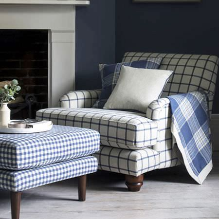 Clarke and Clarke -  Glenmore Fabric Collection - White armchair featuring plaid design in blue, upholstered coffee table with blue chequered design and matching cushions