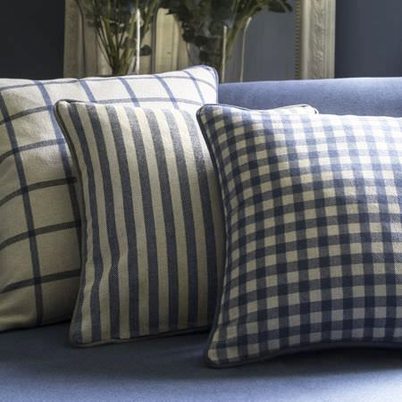 Clarke and Clarke -  Glenmore Fabric Collection - Plain blue upholstered sofa and beige cushions featuring a plaid, chequered and striped patterns in blue