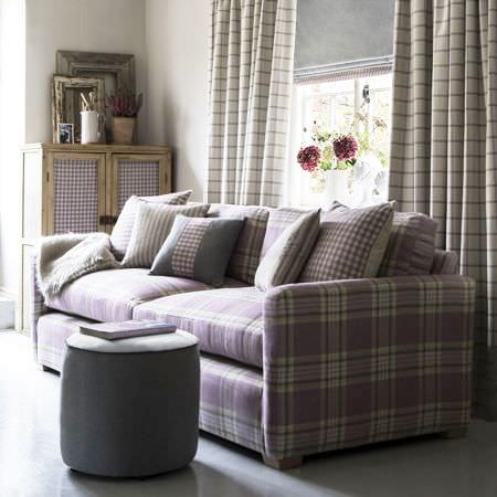 Clarke and Clarke -  Glenmore Fabric Collection - Purple upholstered sofa with a plaid design, cushions with purple chequered pattern and matching curtains