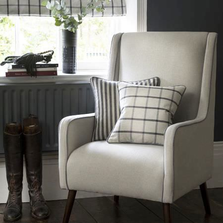 Clarke and Clarke -  Glenmore Fabric Collection - Modern upholstered armchair covered with a beige cushion featuring plaid design and one featuring striped design