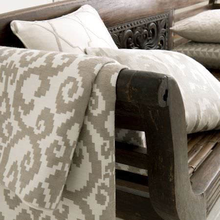 Clarke and Clarke -  Global Luxe Fabric Collection - Beautifully carved dark wood bench with four cream cushions, and cream fabric with a grey-brown pixelated swirl pattern