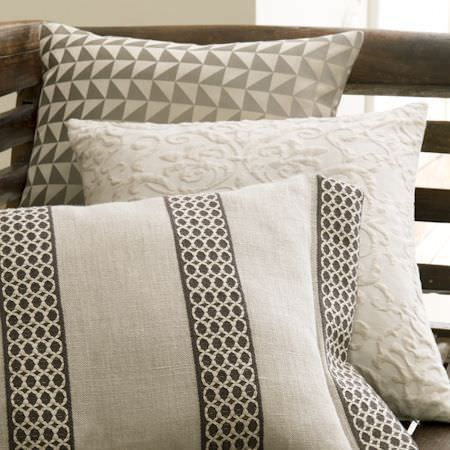 Clarke and Clarke -  Global Luxe Fabric Collection - Bench with three cushions; brown and cream tesselated triangle print, cream with textured florals, and cream with brown crocheted stripes