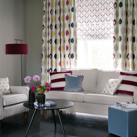 Clarke and Clarke -  Gustavo Fabric Collection - Leaf print curtains, co-ordinating blinds, plain and patterned cushions, a white sofa and armchair, and a black table