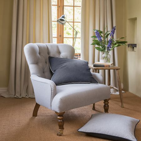 Clarke and Clarke -  Highlander Fabric Collection - Elegant white upholstered armchair with buttons and two plain cushions, one in light grey other in dark grey