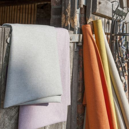Clarke and Clarke -  Highlander Fabric Collection - Modern plain fabrics from the Highlander Fabrics Collection dyed in beige, orange, yellow and light purple