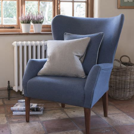 Clarke and Clarke -  Highlander Fabric Collection - Modern plain armchair in blue with a cushion in the same shade of blue and another one in light grey