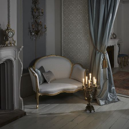 Clarke and Clarke -  Imperiale Fabric Collection - Luxurious armchair with gold edges, silver curtain with elegant pattern and elegant floral design on wallpaper