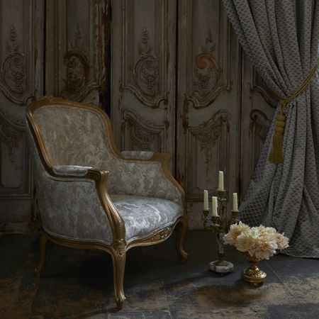Clarke and Clarke -  Imperiale Fabric Collection - Upholstered vintage armchair featuring silver floral pattern and a luxurious curtain in silver