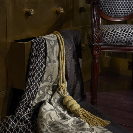 Clarke and Clarke -  Imperiale Fabric Collection - A close-up view of luxurious fabrics in black, silver and grey from the Imperiale Fabrics Collection