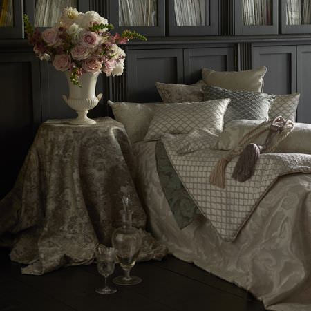 Clarke and Clarke -  Imperiale Fabric Collection - A collection of deluxe tablecloth and furniture covers and luxurious decorative cushions in beige and silver