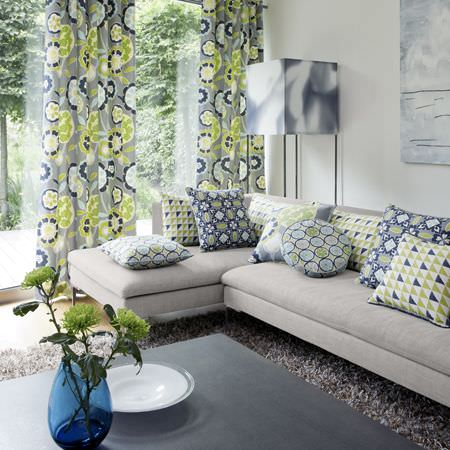 Clarke and Clarke -  Impressions Fabric Collection - Grey, blue and green bright flower print curtains and modern patterned cushions