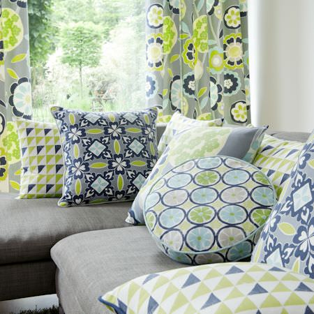 Clarke and Clarke -  Impressions Fabric Collection - Blue and green bold printed round and square cushions with modern flower patterned curtain
