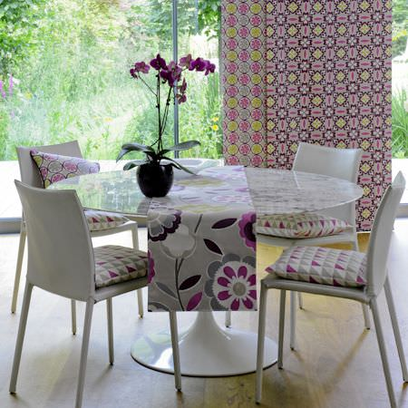 Clarke and Clarke -  Impressions Fabric Collection - Geometric patterned seat cushions and modern floral tablecloth in purple and grey
