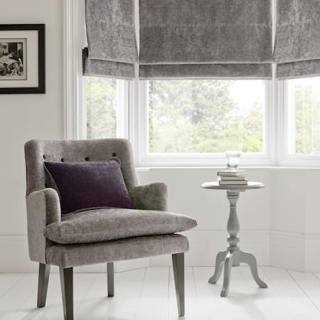 Clarke and Clarke -  Karina Fabric Collection - Grey velvet upholstery and roman blinds in a simple, minimalist setting
