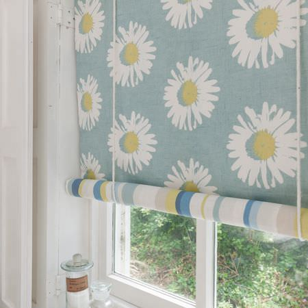 Clarke and Clarke -  La Vie En Rose Fabric Collection - A double-sided roller blind withwhite, light green and dusky blue daisies on one side andmatching stripes on the other