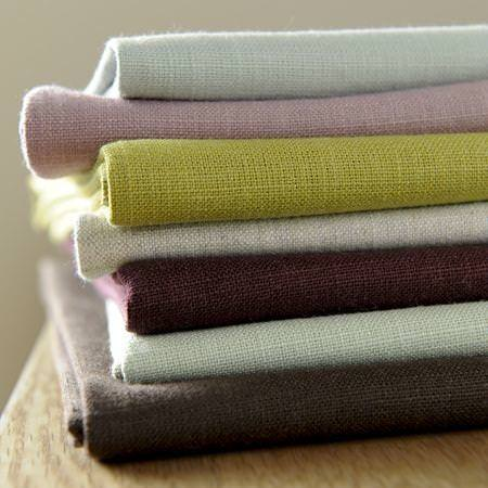 Clarke and Clarke -  Lindow Fabric Collection - Green, brown and blue linen fabrics