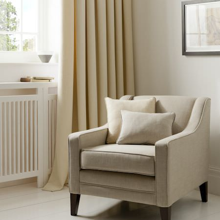 Clarke and Clarke -  Linoso Fabric Collection - Pleated curtains, upholstery and cushions of yellow, creamy linen